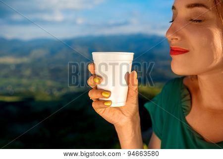 Woman enjoying coffee to go