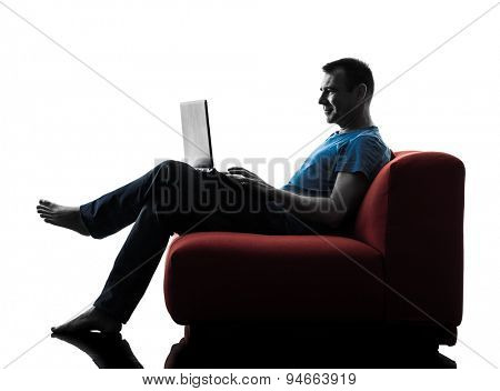 one caucasian man sofa coach computer computing laptop in silhouette isolated on white background