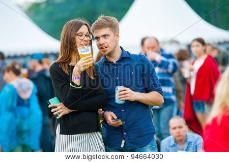 MOSCOW - JUNE 20, 2015: Young couple drink beer on XII International Jazz Festival