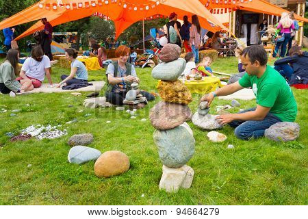 MOSCOW - JUNE 20, 2015: People build cairns on XII International Jazz Festival