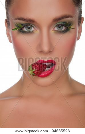Face Of Charming Woman With Strawberry In Mouth