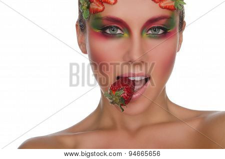 Young Woman With Strawberries On Face And Teeth