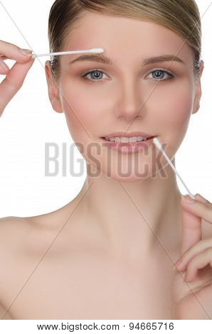 Woman Holding Cotton Swabs In Mouth And Eyes