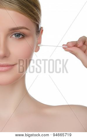 Portrait Of Woman Brushing Ear With Cotton Swab