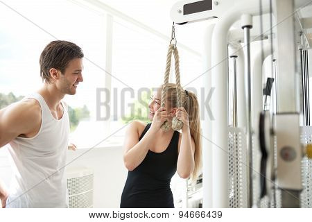 Male Trainer Talking To Woman Inside The Gym