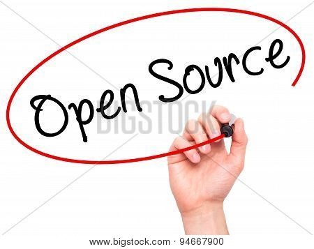 Man Hand writing Open Source with black marker on visual screen.