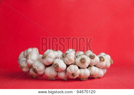 Red Background With A Bunch Of Garlic