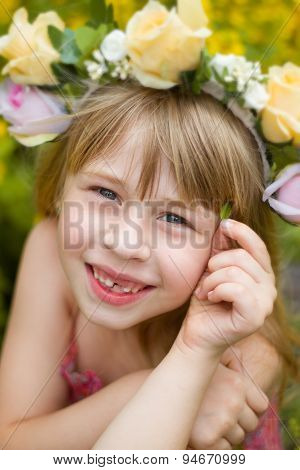 little girl in wreath of flowers