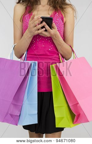 Shopping Woman With A Smart Phone In Her Hands