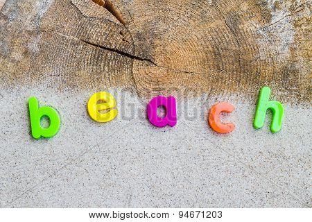 The Word Beach Laid Sand