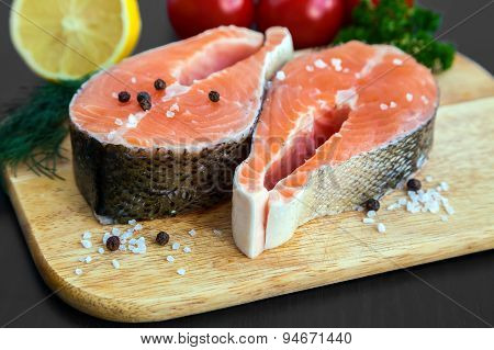 Raw Salmon Steaks With Salt And Black Pepper