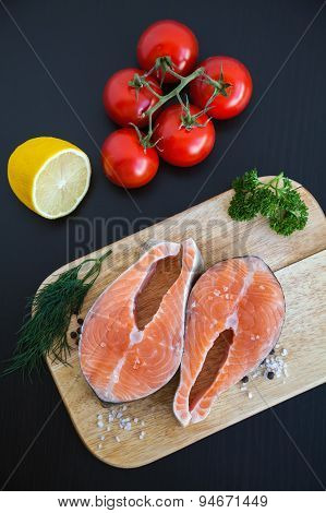 Salmon Steaks On A Wooden Board