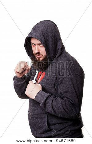Boxer athlete with a huge beard hooded worth hands clenched into