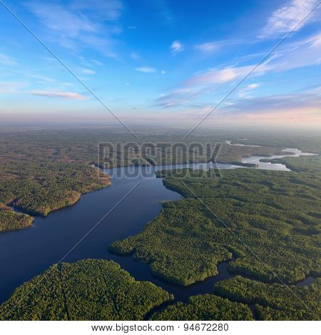 Forest river in summer evening, top view