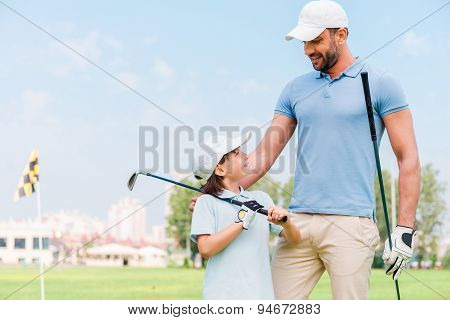 Little Golfer With Father.