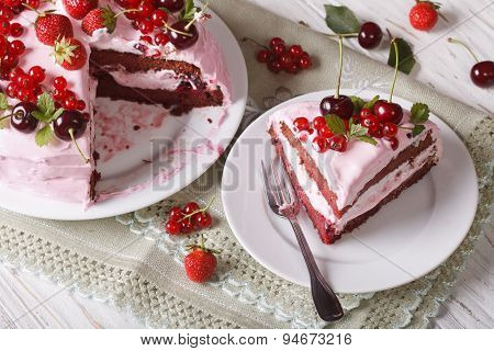 Homemade Pink Cake With Fresh Berries, Sliced On A Plate