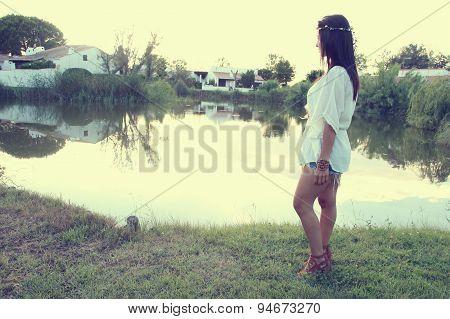 Woman next to a pond