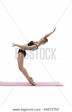 Cute girl posing in difficult equilibrium position