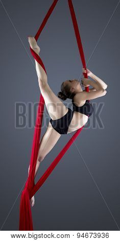 Image of flexible young dancer on aerial silks