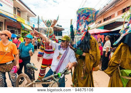 LOEI PROVINCE THAILAND-JUNE 27: People at Ghost Festival (Phi Ta Khon) Ghost masked procession celebrated on religious tradition