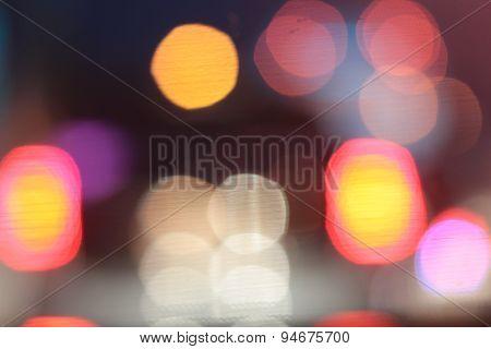 Blurred Bokeh Of Car In City At Night.