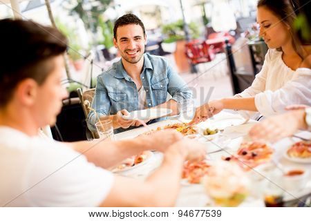 Young People By The Table
