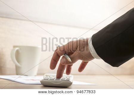 Businessman Or Accountant Doing A Calculation On A Calculator