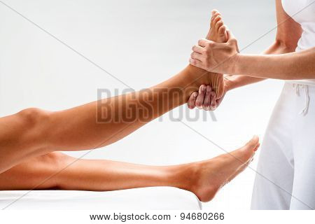 Osteopath Massaging Female Foot.