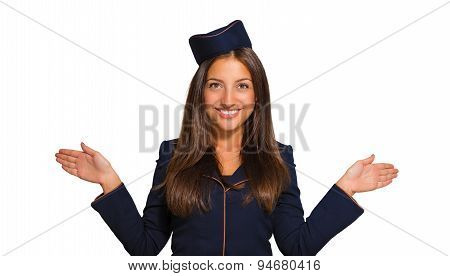 Portrait of a beautiful young woman dressed as a stewardess on a white background