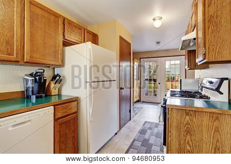 Traditional Kitchen With Tile Floor And Lots Of Cabients.