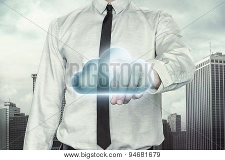 Cloud computing concept with businessman on cityscape background