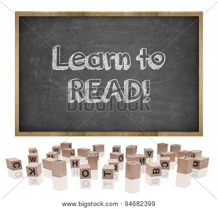 Learn to lead concept on blackboard with wooden frame and block letters