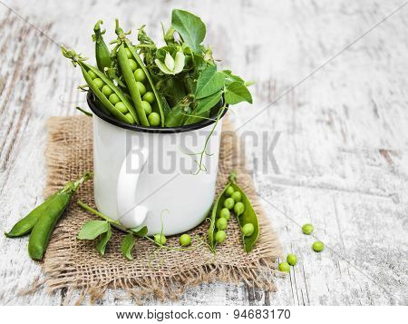 Metal Cup With Fresh Peas