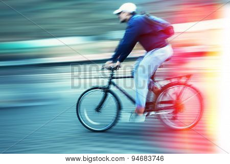 Abstract Image Of Cyclist On The City Roadway.