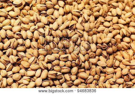 Pistachios Background On A Market Stall Close-up. Food Healthy Backdrop