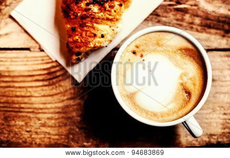 Croissants With Coffee On Wooden Background