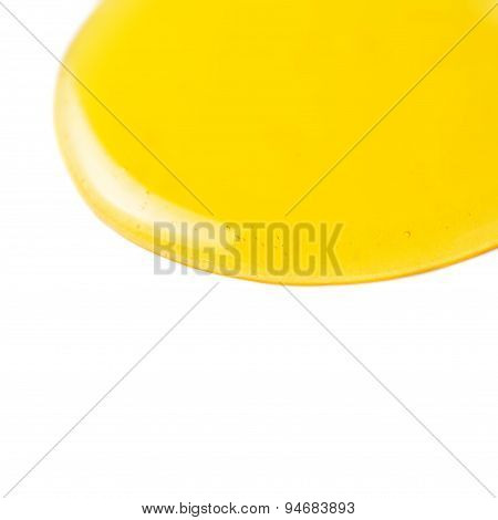 Yellow Honey Flowing Liquid  Drop  Isolated On White Background Macro.