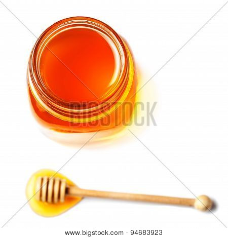 Fresh Honey With A Honey Dipper Isolated On White Background , Macro.