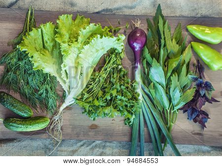 Greens, Salad, Cucumber, Pepper, Onion, Basil On A Wooden Board