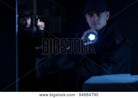 Policeman Holding Flashlight