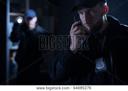 Policeman Calling For Back Up