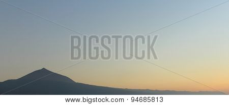 sunset sky with mountain silhouette - background