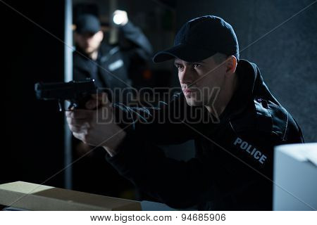 Policeman Aiming Gun During Action