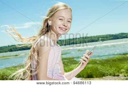 Adorable little girl on beach vacation