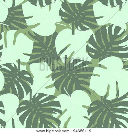 Seamless camouflage pattern of palm leaves dark green