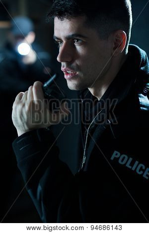 Police Officer Holding Radio