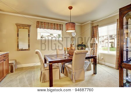 Elegant Dinning Room With Carpet And Table.