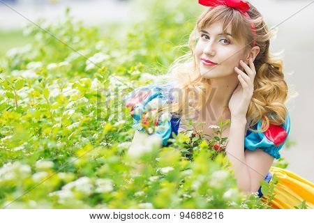 Woman posing in the green bushes