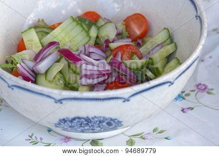 Sallad In A White And Blue Bowl