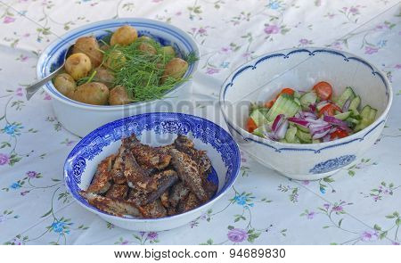 Three Bowles With Herring, Potato And Sallad